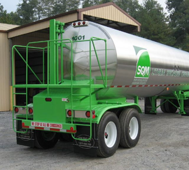 Green and white propane trailer
